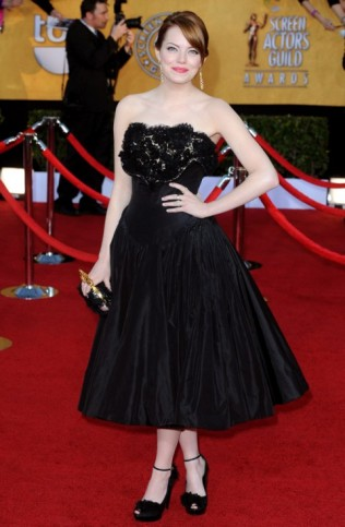 Emma Stone: stepped up her style in 2012 wearing a 50s silhouette Alexander McQueen, and added an element of funk with the knuckleduster clutch.