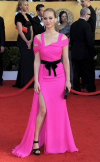 Jennifer Lawrence: back in the days before all she wore was Dior, she stunned on the 2011 red carpet in this Shocking Pink Oscar de la Renta gown.