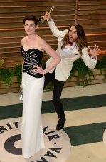 Anne Hathaway in custom Viktor + Rolf, photo-bombed by Jared Leto {Vanity Fair Oscar Party}