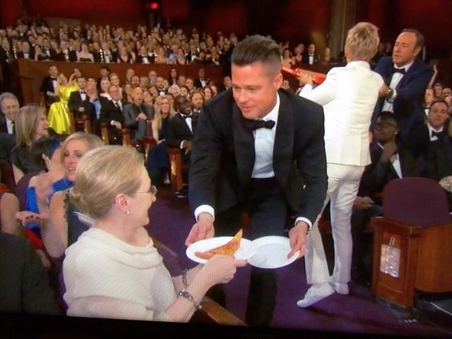 Brad serving Meryl Pizza