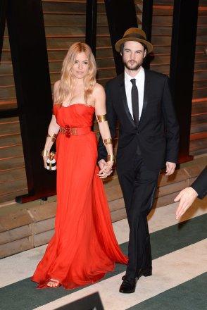 Sienna Miller in Alexander McQueen with fiancé Tom Sturridge {2014 Vanity Fair Oscar Party hosted by Graydon Carter}