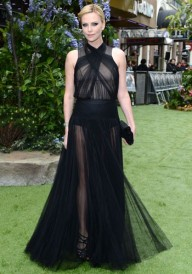 CHARLIZE THERON In a Dior Haute Couture gown at the Snow White and The Huntsman premiere in London in 2012.