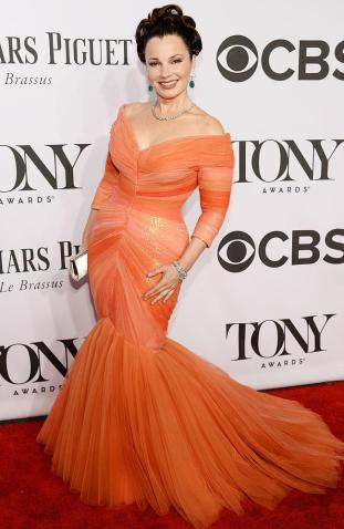 I don't know how I feel about this coral tulle number, but I love Fran Drescher so much, that I am completely bias | Fran Drescher arrives at the 2014 Tony Awards Red Carpet.