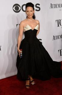Lucy Liu in Vivienne Westwood gown, Nicholas Kirkwood shoes, a Judith Leiber bag, and Lorraine Schwartz jewelry, arrives at the 2014 Tony Awards Red Carpet.