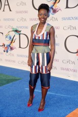 Lupita Nyong'o in custom Suno top and pants; Jennifer Fisher jewelry; Sophia Webster Coco pumps.